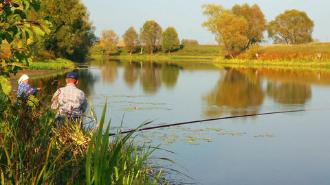 Fishing Senior Couple On Autumn Lake - Timelapse stock footage