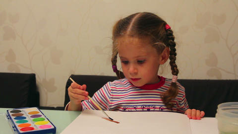 little girl draws paints Footage