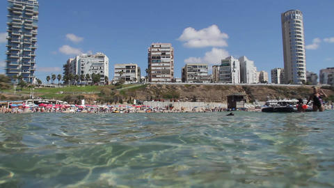 Crowded Beach. Shooting From The Water stock footage
