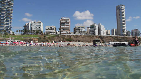 Crowded beach. Shooting from the water Stock Video Footage