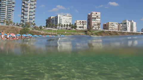 View of the beach from the sea. Underwater View Footage