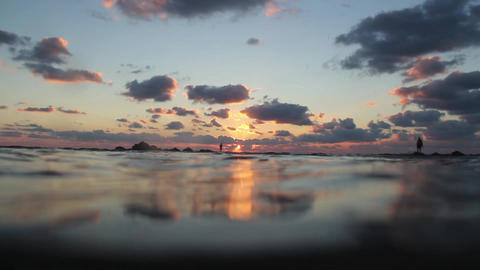 Paradise sunset. Shooting from the water Footage