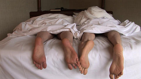 Feet of Couple in Bed Footage
