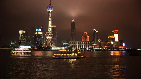 Brightly lit ship passing Shanghai, Pudong in China Footage