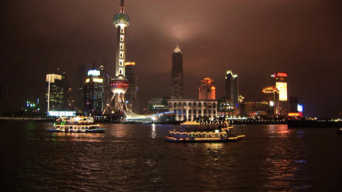 Brightly lit ship passing Shanghai, Pudong Stock Video Footage