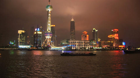 Brightly lit ship passing Shanghai, Pudong Footage
