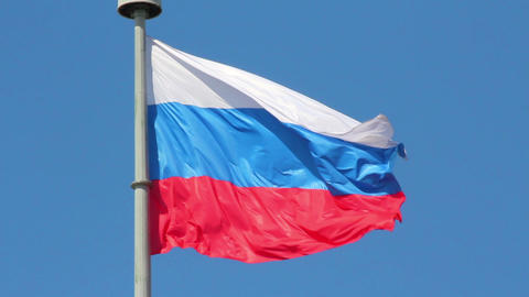 russian flag on blue sky background Stock Video Footage