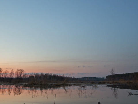Sunset and starry sky reflected in lake. Zoom. Tim Stock Video Footage