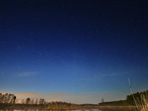 Sunset and starry sky reflected in lake. Zoom. Tim Footage