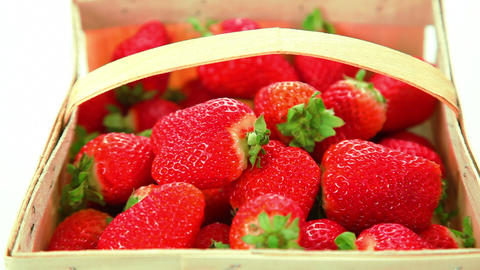 Basket of strawberries on white background Footage
