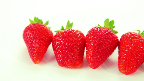 Beautiful red strawberry on white background Footage