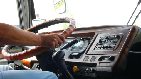 man's hand driving in bus Footage