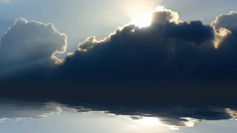 timelapse with sun behind clouds over sea Stock Video Footage