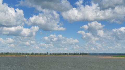 Timelapse With Clouds Moving Over River - Zoom Out stock footage