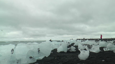 Icebergs On Lava Beach At Jökulsarlon Glacier Out stock footage