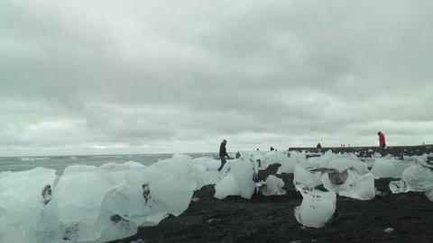 icebergs on lava beach at jökulsarlon glacier out Stock Video Footage