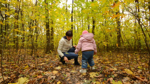 Little Baby is Playing with Mother in Autumn Color Stock Video Footage