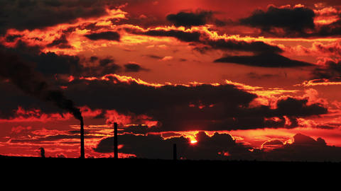 Factory Pipe Polluting Air At Sunset. Environmenta stock footage
