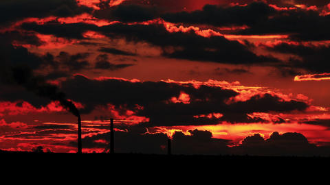 Factory pipe polluting air at sunset. environmenta Stock Video Footage