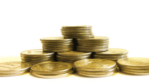 growing pyramid of coins isolated on white, moving Stock Video Footage