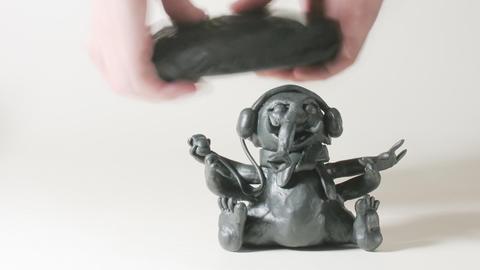 timelapse sculptor modeling plasticine figure of G Footage