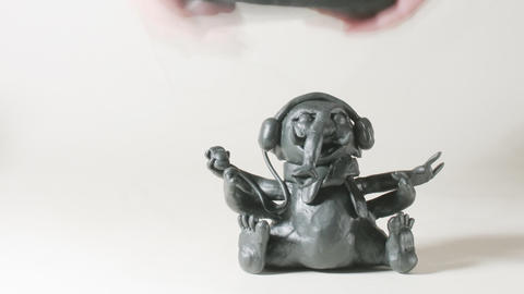 timelapse sculptor modeling plasticine figure of G Stock Video Footage