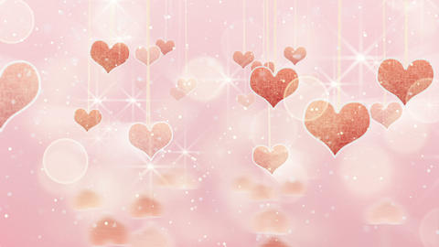 pink hearts dangling on strings and glares loop Stock Video Footage
