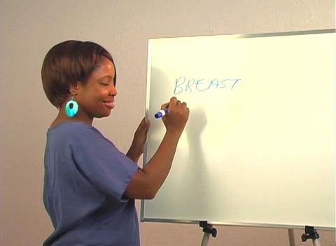 "Beautiful Nurse Writes ""Breast Implants"" on a White Board Stock Video Footage"
