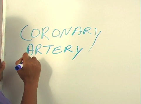 "Beautiful Nurse Writes ""Coronary Artery Bypass"" on a White Board (close-up) Footage"