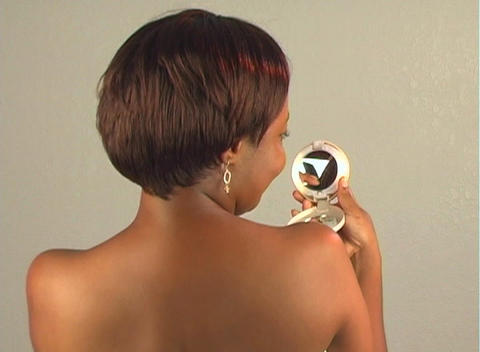 Beautiful Woman Fixes Her Hair with Compact Mirror Footage