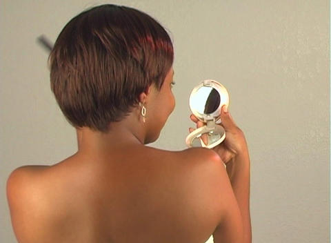 Beautiful Woman Fixes Her Hair with Compact Mirror Stock Video Footage