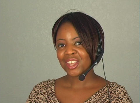 Beautiful Customer Service Operator with Headset Microphone Stock Video Footage