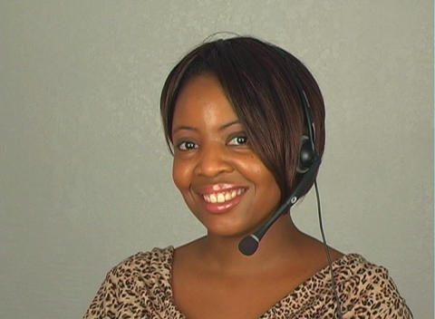 Beautiful Customer Service Operator with Headset Microphone Footage