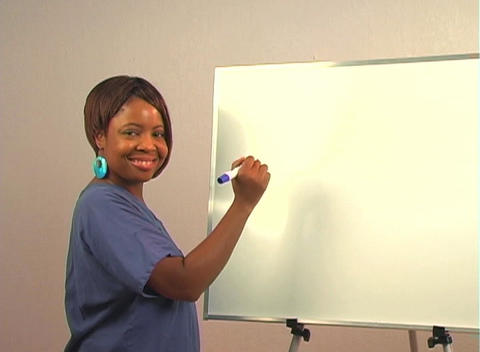 "Beautiful Nurse Writes ""D&C"" on a White Board Stock Video Footage"