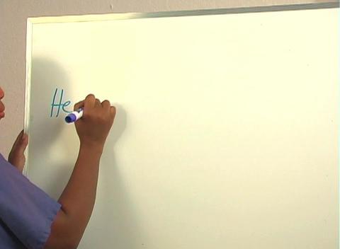 "Beautiful Nurse Writes ""Hemorrhoidectomy"" on a White... Stock Video Footage"