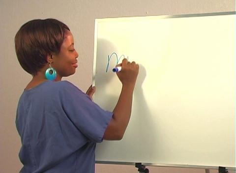 "Beautiful Nurse Writes ""Mastectomy"" on a White Board Stock Video Footage"