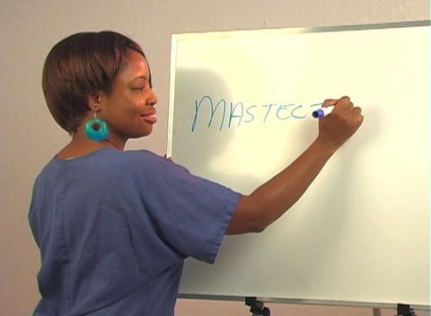 "Beautiful Nurse Writes ""Mastectomy"" on a White Board Footage"