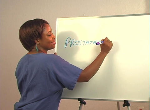 "Beautiful Nurse Writes ""Prostatectomy"" on a White Board Footage"