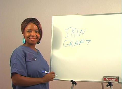 "Beautiful Nurse Writes ""Skin Graft"" on a White Board Footage"