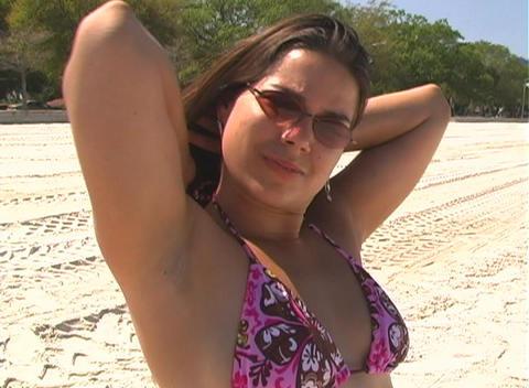 Bikini-clad Brunette on the Beach-1i Stock Video Footage