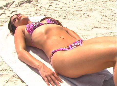 Bikini-clad Brunette on the Beach-1k Stock Video Footage