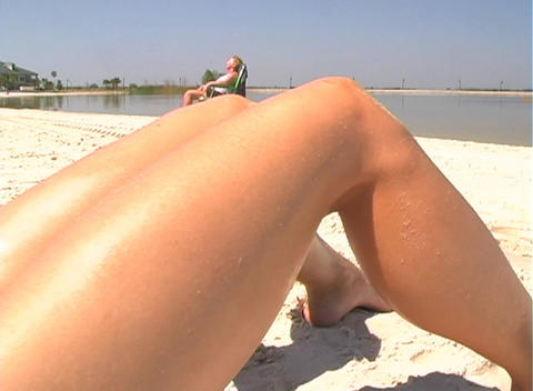 Bikini-clad Brunette on the Beach-3b Stock Video Footage