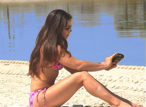Bikini-clad Brunette on the Beach-14 Stock Video Footage