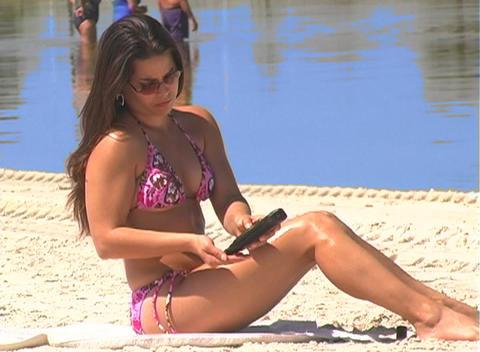 Bikini-clad Brunette on the Beach-16 Stock Video Footage