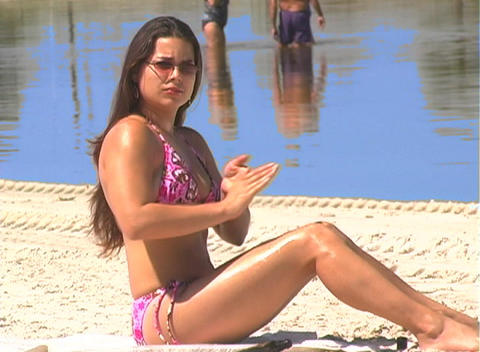 Bikini-clad Brunette on the Beach-16 Footage