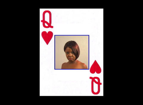 Beautiful Woman inside a Queen of Hearts playing card (close-up) Footage