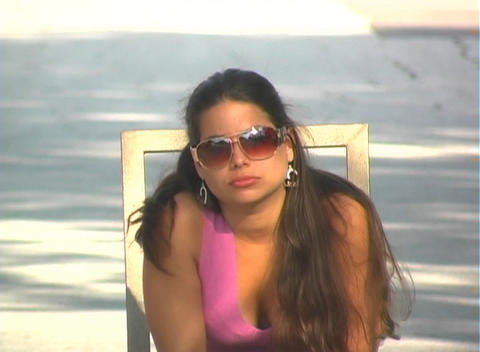 Beautiful Brunette Sitting in a Street-2 Stock Video Footage