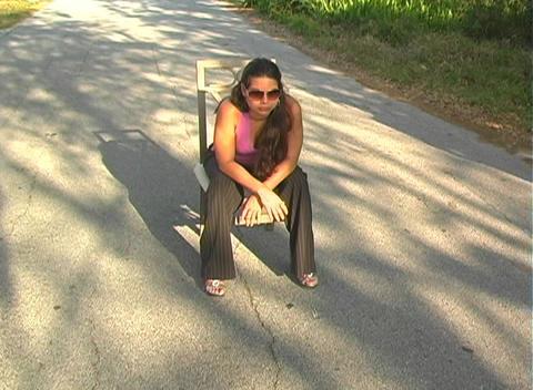 Beautiful Brunette Sitting in a Street-4 Stock Video Footage