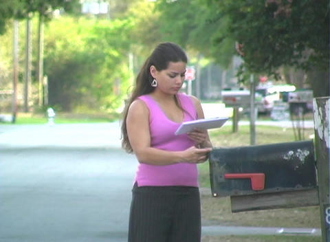 Hot Brunette Gets her Mail-1a Stock Video Footage