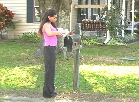 Hot Brunette Gets her Mail-2b Stock Video Footage
